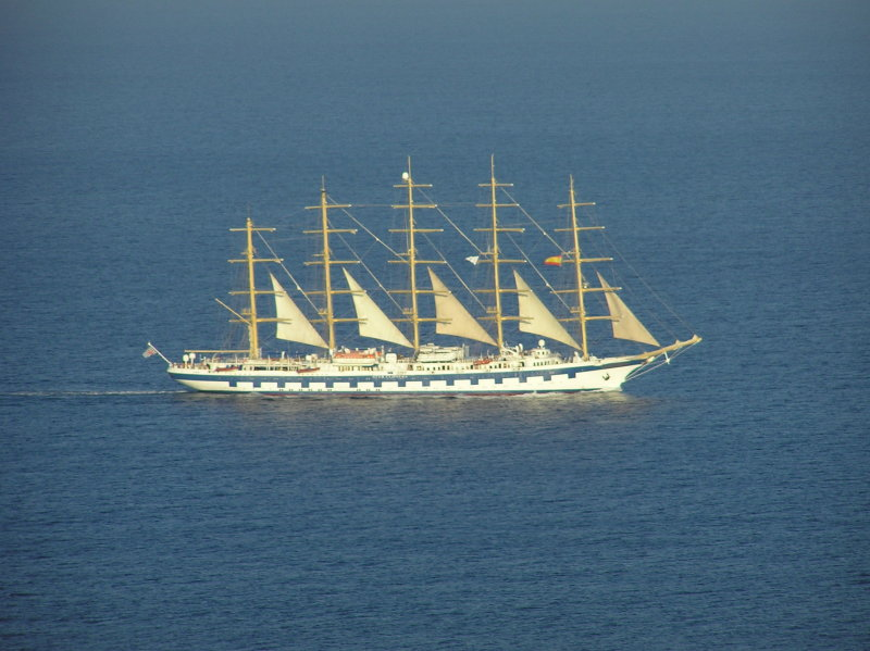 Royal Clipper passes La Mola in the late evening sun