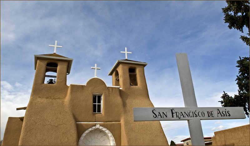 San Francisco de Asis with sign