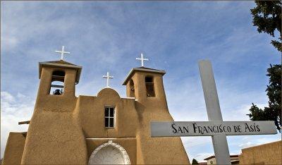 San Francisco de Asis with sign