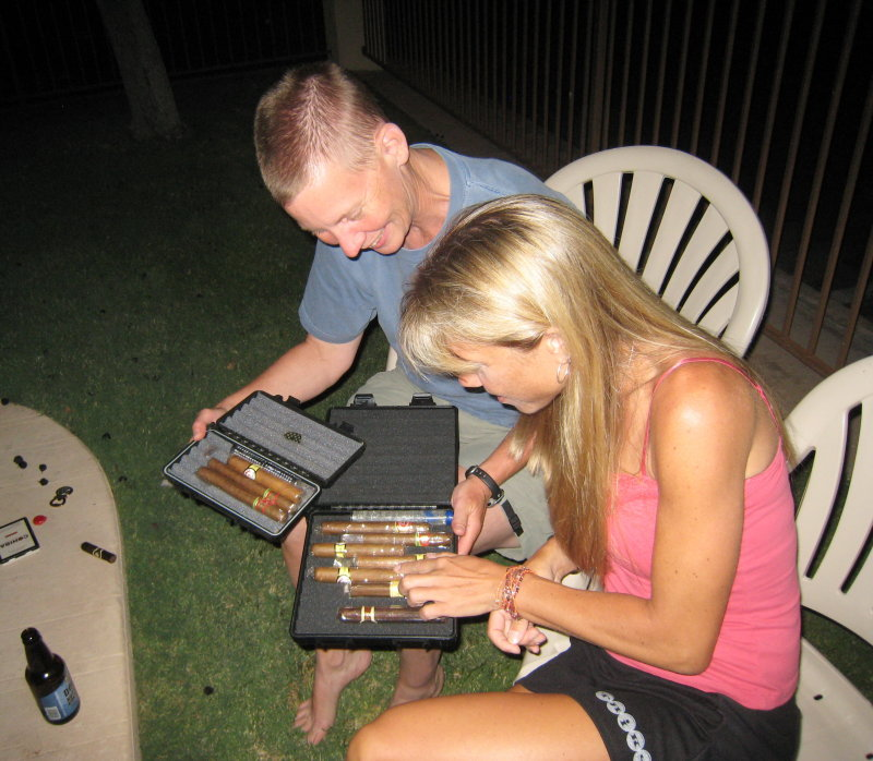 selecting a cigar at the post-post-race party by the pool.