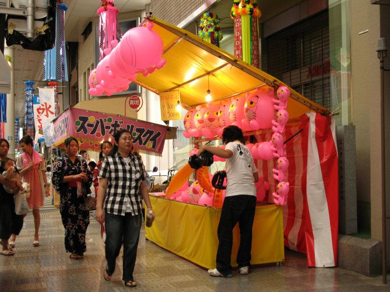 Pink panther balloons at a yatai