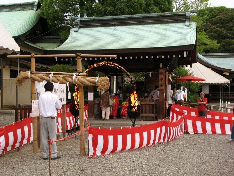 Flame-ringed arch in front of a smaller shrine