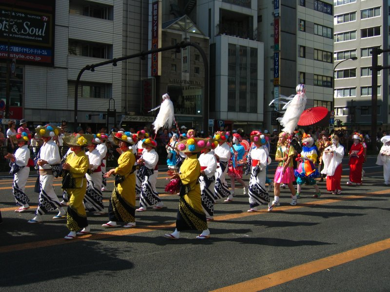 Procession of dancers in traditional garb