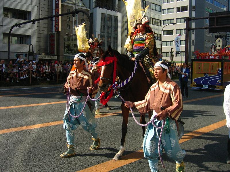Samurai on horseback with attendants