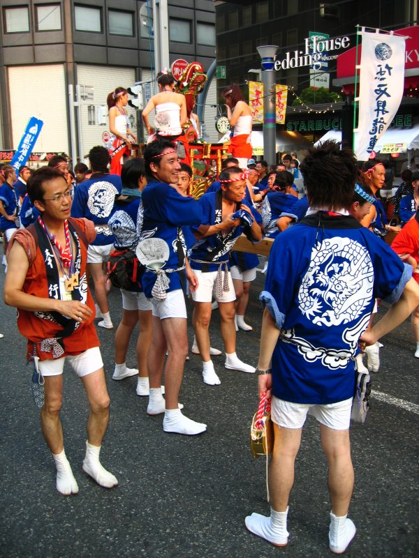 Mikoshi attendants resting in a lull