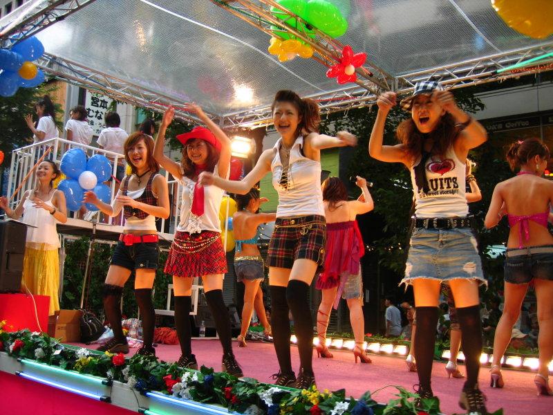 Stage girls atop the Mitsukoshi float