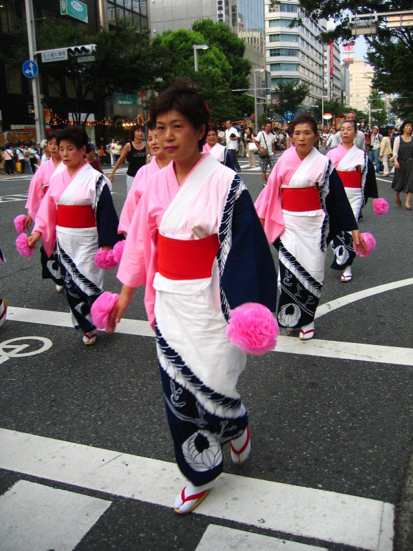 Bon dancers starting down the street