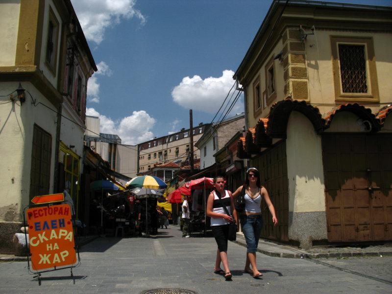 Siblings walking through the bazaar