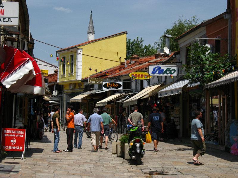 Čaršija bazaar scene with minaret