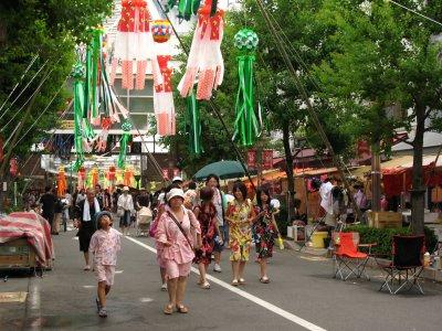 Festival-goers in traditional summer dress