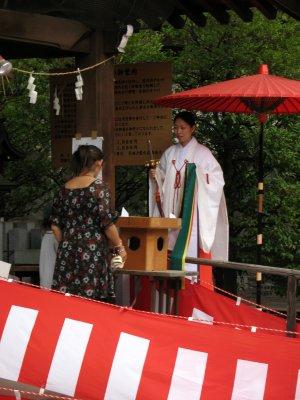 Shrine attendant offering a blessing