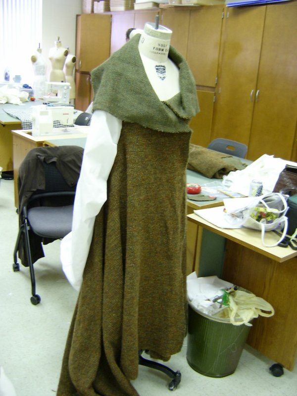 Coat on Form with Muslin Sleeve