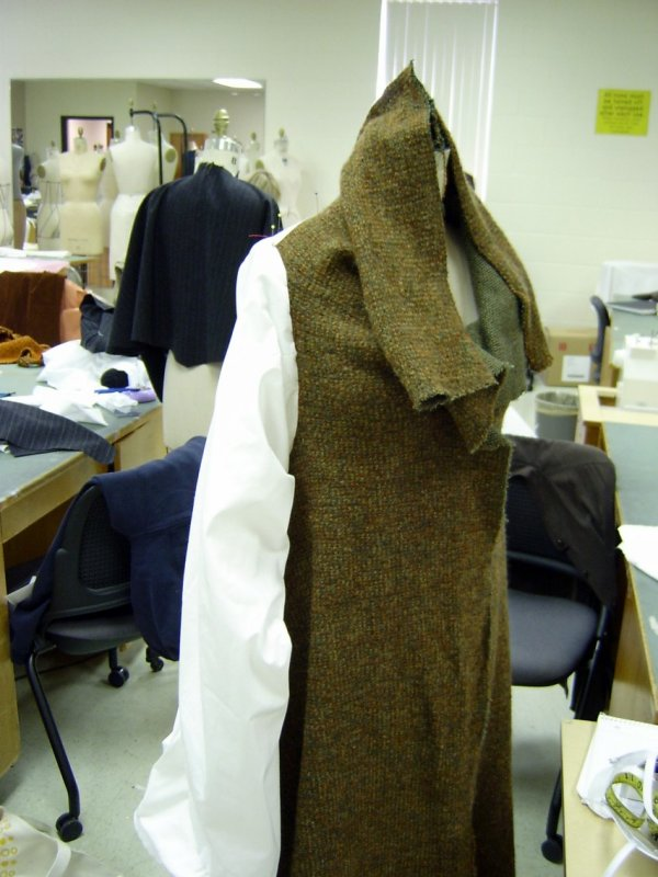 Coat on Form with Muslin Sleeve, with Collar Raised