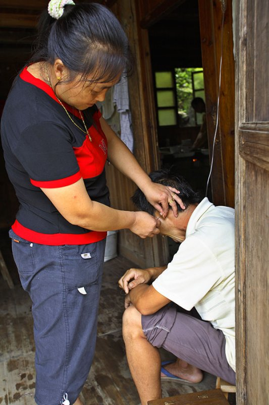 1715 Collecting a blood sample at the village infirmary.