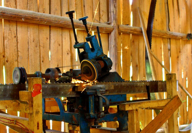 0284 Automatic sharpener used for the saw in a small local lumber mill.