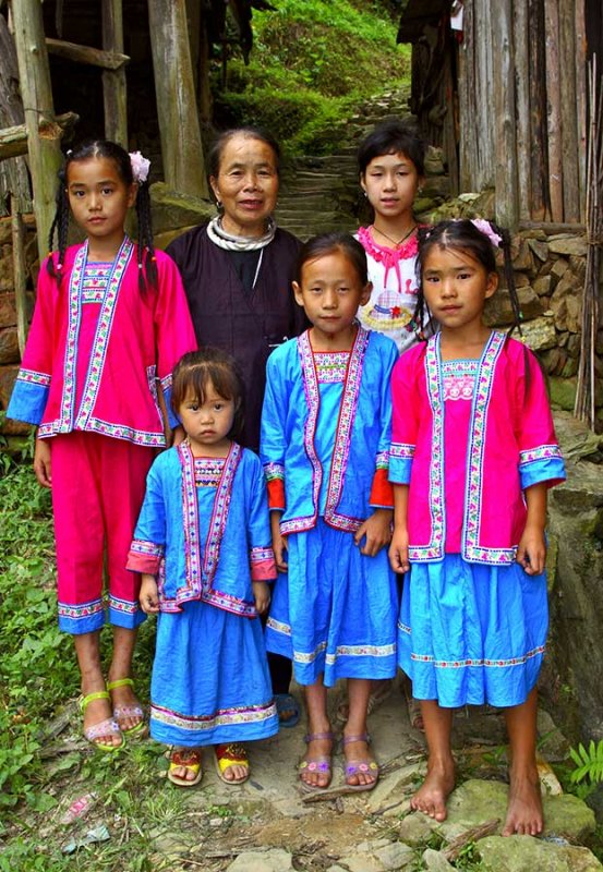 1283 Kam girls and elder in traditonal clothes.