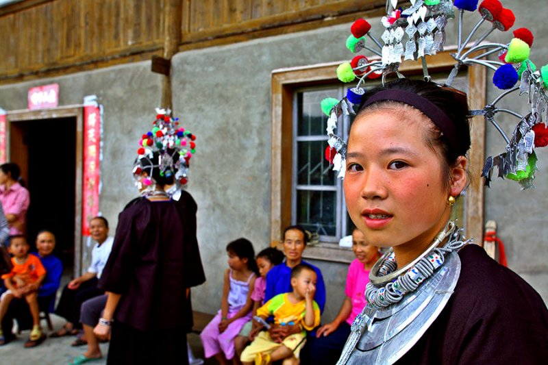 3186 Young Kam woman with traditional headdress for the new drum tower celebration.