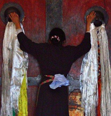 Praying, monastery doors.