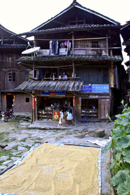 0429 Home and store with rice drying.  ***Explanation***