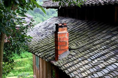 1217 Typical brick chimney and fired clay tile roof.