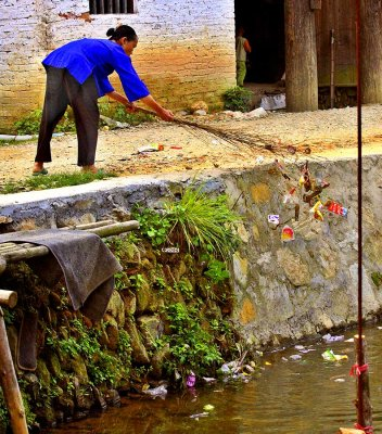 3121 Garbage being swept into community stream.  ***Explanation***