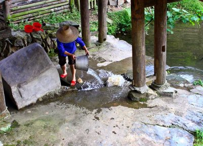 0372 Emptying one of the many local small springs reservoir.