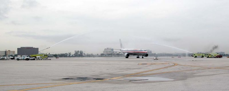 MIA ARFF units honor the return of a fallen soldier with a water cannon salute photo #2113
