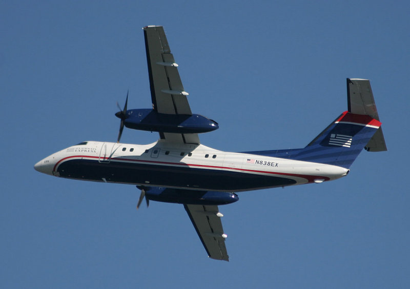 Dash-8 in US Airways new livery taking off LGA RWY 31