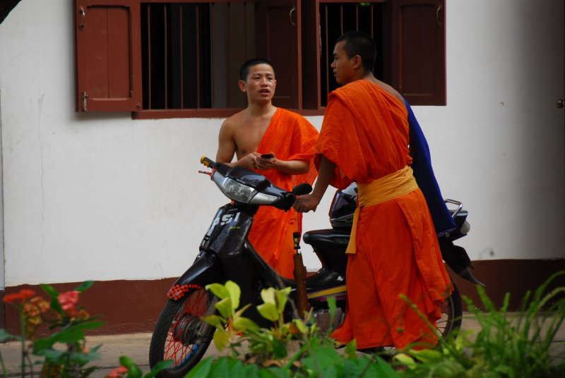 Monks with Cell and Bike