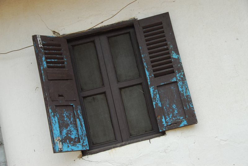 Luang Prabang Window with Weathered Shutters