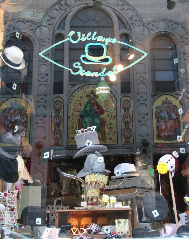 Village Scandal Shop Window with Church Reflection