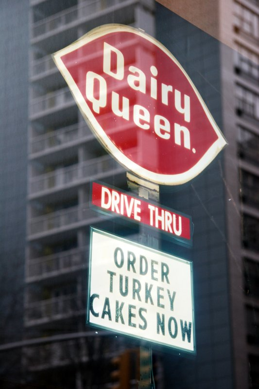 Dairy Queen Sign  with Window Reflection of LaGuardia Place Residences