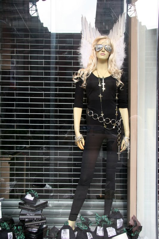 Angel Mannequin in a Store Window
