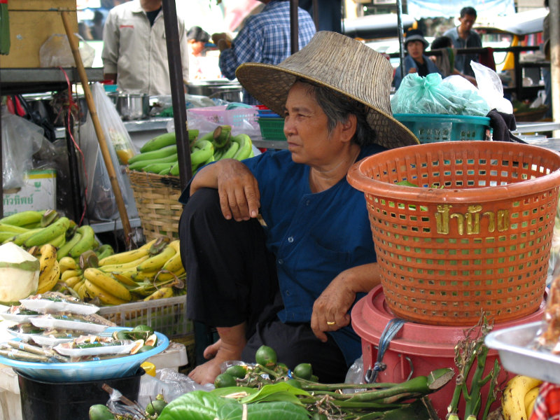 Fruit Seller Keeping Cool With a bag of Ice Under Her Cooley Hat