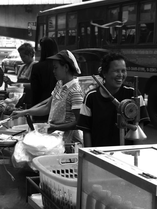 Sukhumvit Stall Holders Joking Whilst They Work