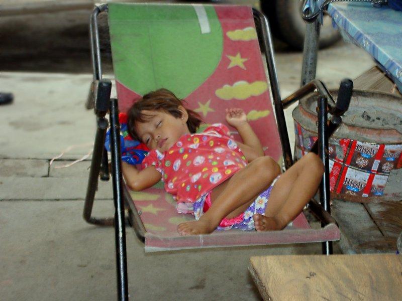 Little Girl Sleeping Whilst Her Mother Works at Rangsit Market
