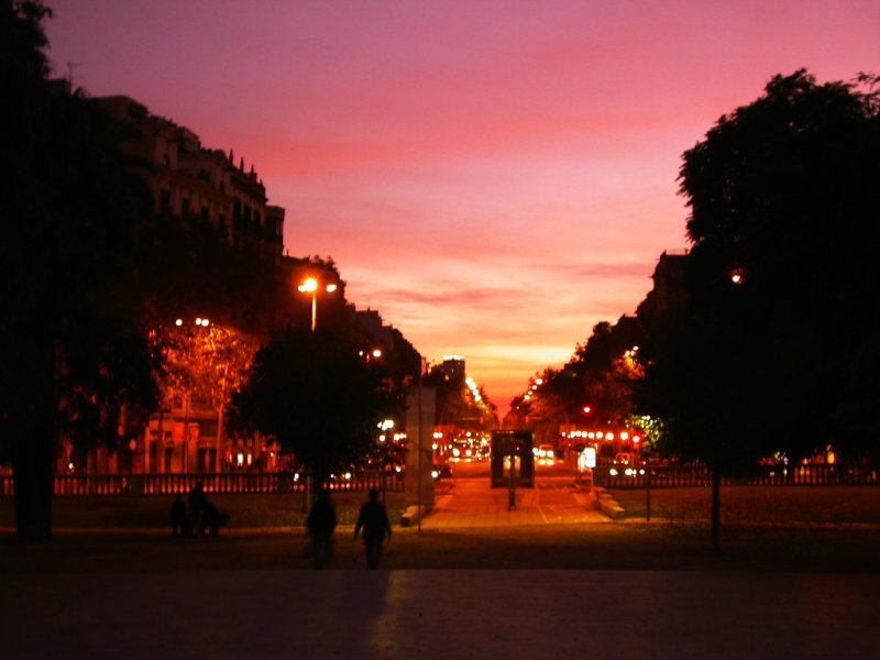 Sun setting down Avenida Diagonal - as the sun sets, the city gets a new lease of life