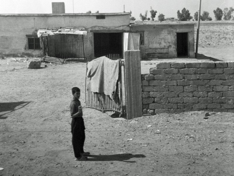 Iraqi Boy Cautiously Waving