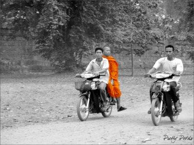 Monk Riding On A Bike