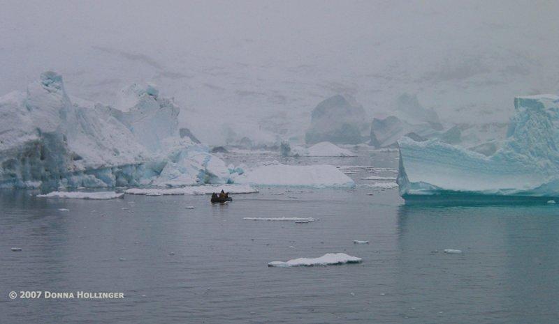 Zodiac investigating iceberg clusters near the shore