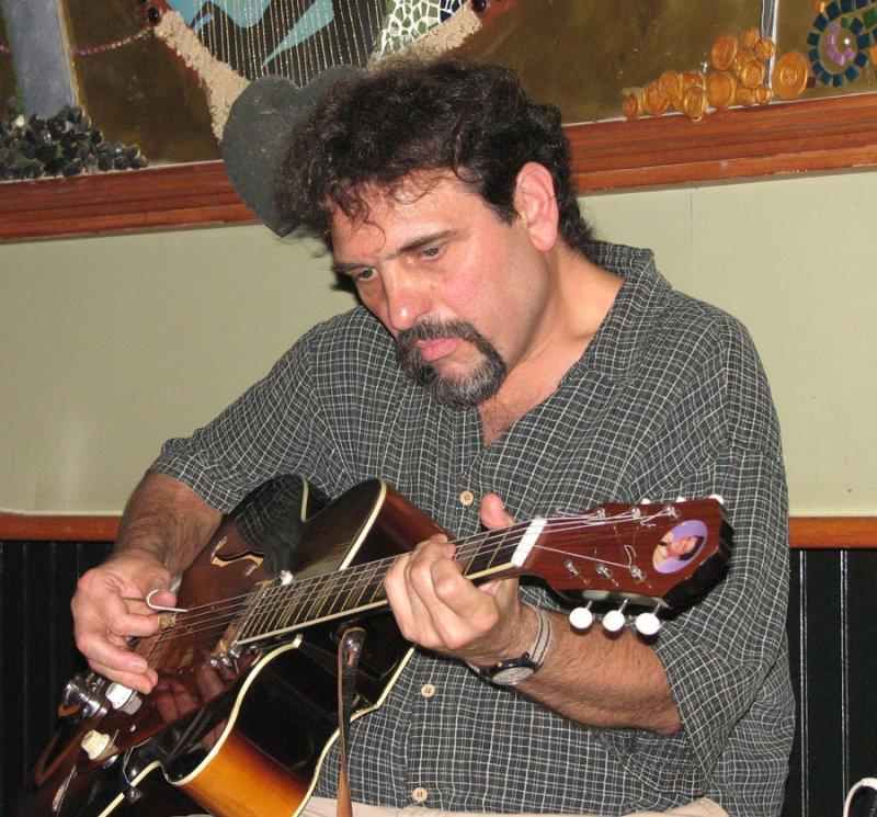 Henri Nigro Playing Guitar
