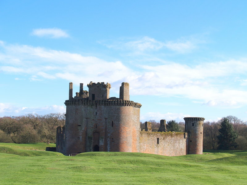 Caerlaverock Castle,nestling within its defensive earthworks