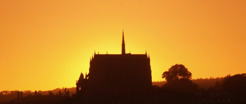 Roman Catholic Cathedral at Arundel,silhouetted by the setting sun.
