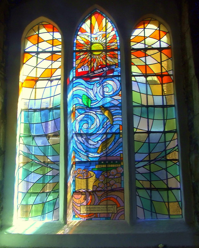 Stained glass window dedicated to local oystermen and cocklers.