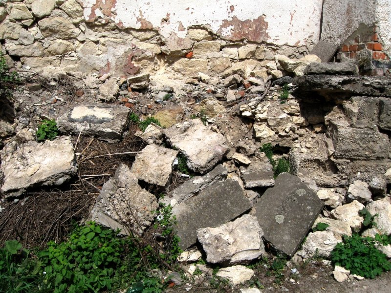 the wall of stones has been partially disassembled
