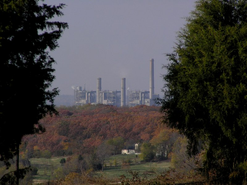 The power plant is about 5 miles away. The white brick house is about 1 mile.