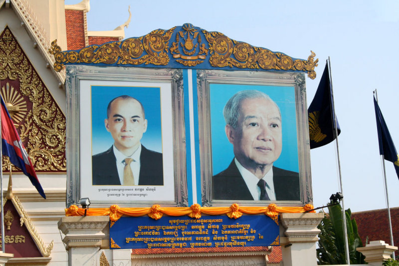 Close-up of billboard of the father and son kings.