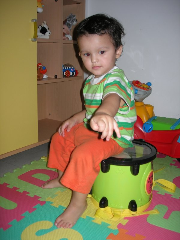 Posing for dad on his drum