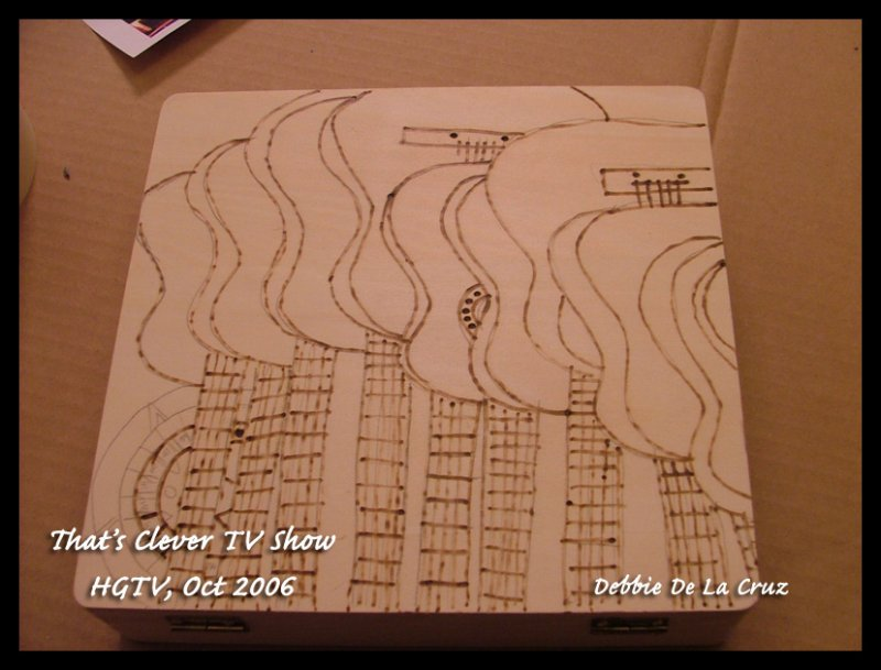 Pyrography only on box.