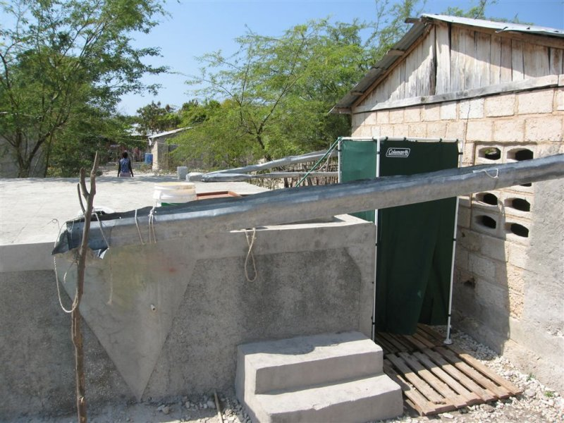 gutters on the buildings that drain into this tank, which is used for their driking water